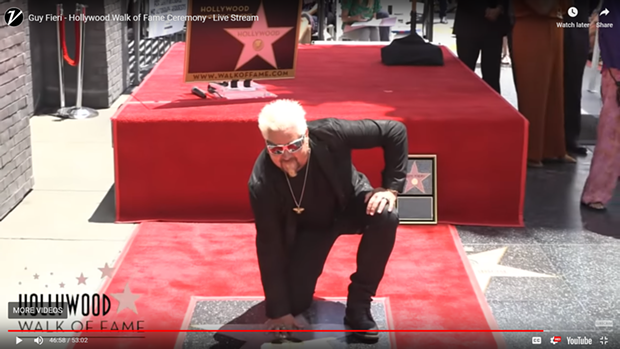 A screenshot of Guy Fieri and his star. - WALK OF FAME VIDEO