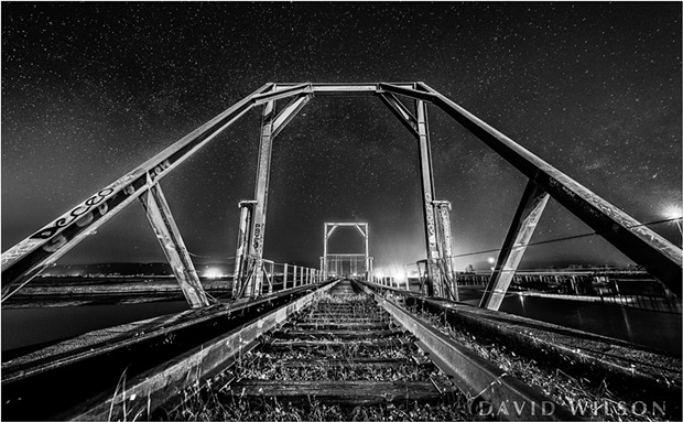 A night on the old Railroad bridge over the Eureka Slough at the north end of Eureka, Humboldt County, California. Trains thundered down these tracks regularly back in the day. Photographed June 7, 2018. - DAVID WILSON