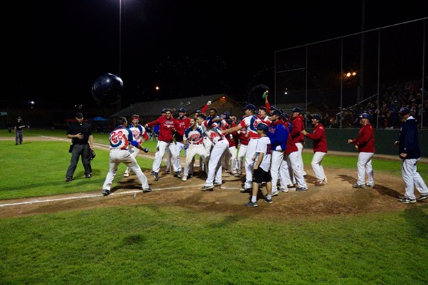 Hendo gets mobbed by teammates after his three-run walk off home run (complete with projectile helmet) - MATT FILAR