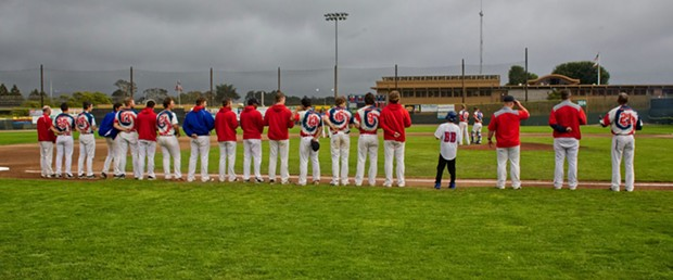 The Crabs stand for the National Anthem in front of a perfect Humboldt summer evening. - MATT FILAR