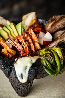 The bubbling molcajete at Fregoso's. - AMY KUMLER