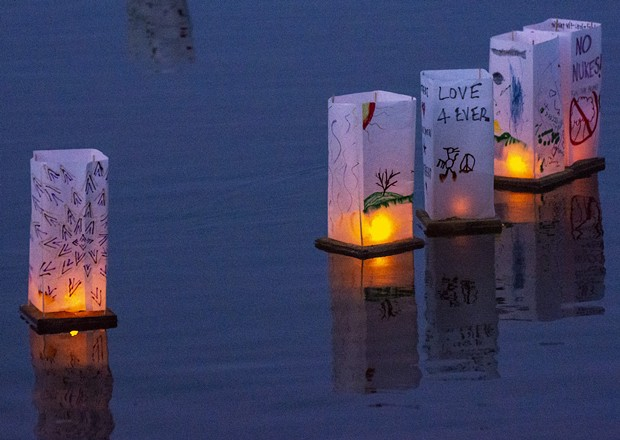 Messages of no-nukes, personal remembrances of loved ones, song lyrics, poetry and art work adorned the floating lanterns. - PHOTO BY MARK LARSON