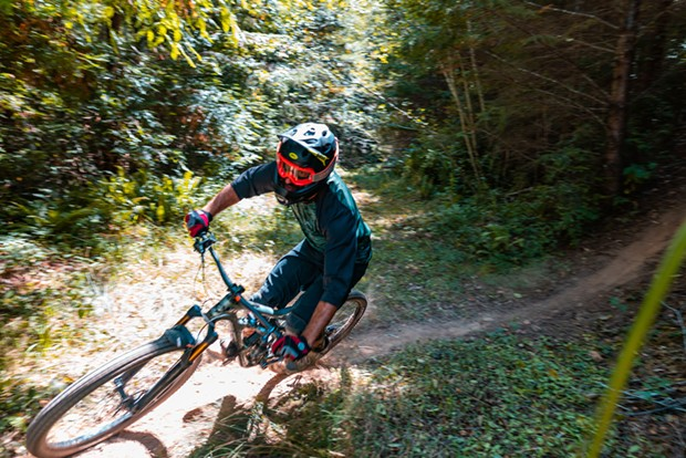 A rider takes on a drop and prepares for another on the trail through Green Diamond property a day ahead of the Mad River Enduro race. - CONNOR RAY PHOTOGRAPHY