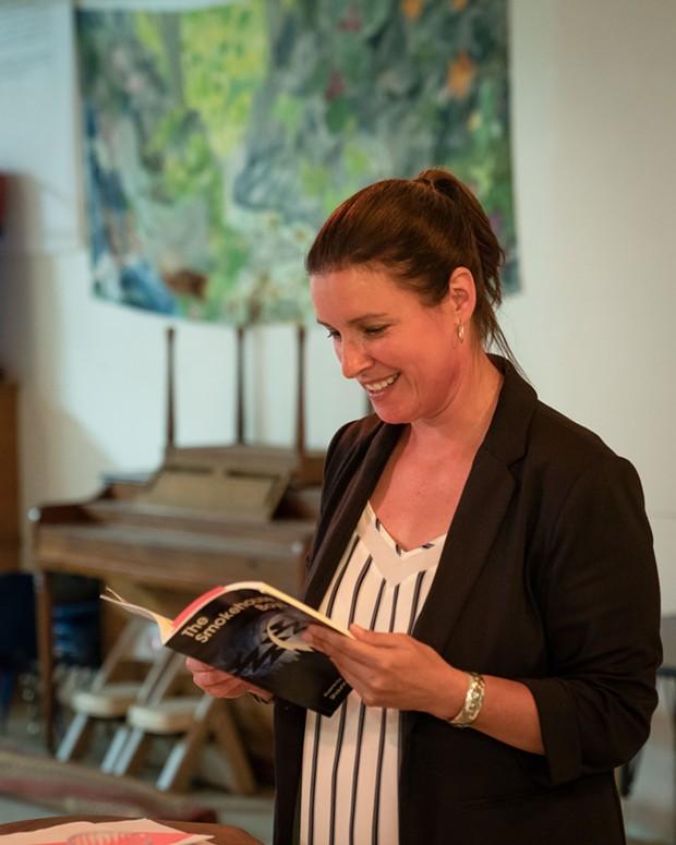 Poet Shaunna McCovey reads her work. - PHOTO BY ZACH LATHOURIS