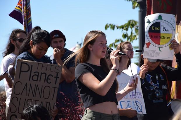 Zoe Reiss, an Arcata High School senior, addressing the crowd at Arcata's Global Climate Strike. - IRIDIAN CASAREZ