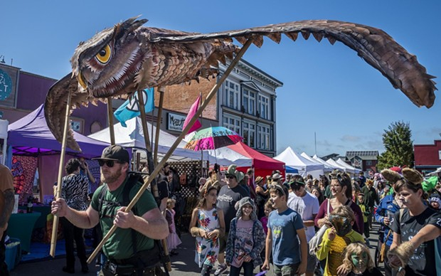 An owl sculpture/puppet flying above the All Species Parade. - PHOTO BY MARK LARSON