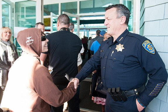 Humboldt State University Police Chief Donn Peterson greets a marcher at a rally in Eureka in celebration of Martin Luther King Jr. Day. - MARK MCKENNA
