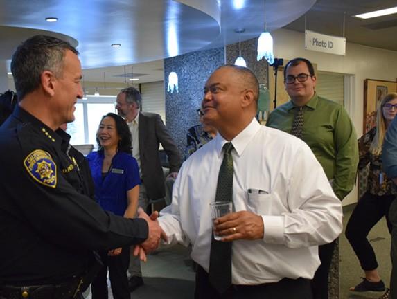 New HSU President Tom Jackson Jr. introducing himself to HSU Police Chief Donn Peterson. - IRIDIAN CASAREZ