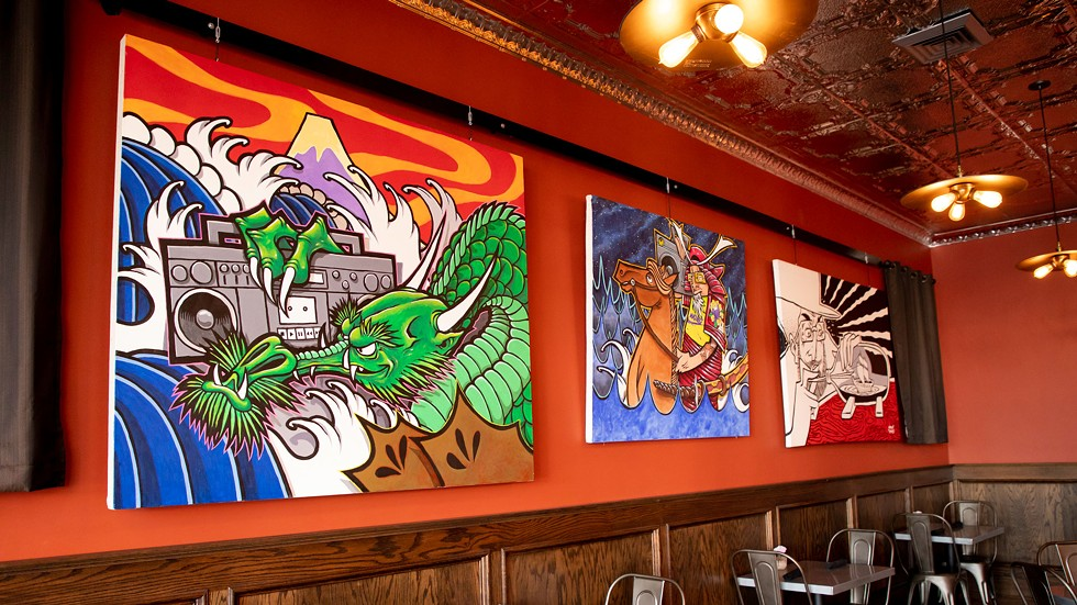 Paintings of Wong's hanging at the Diver Bar & Grill in Eureka. - AMY KUMLER
