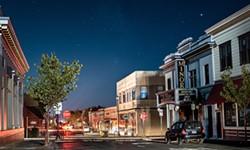 The historic Arcata Minor Theater bathed in moonlight beneath the stars during the PG&E power shutoff. - DAVID WILSON