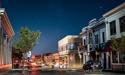 The historic Arcata Minor Theater bathed in moonlight beneath the stars during the PG&E power shutoff. - DAVID WILSON