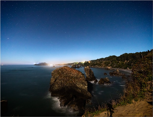 At the western edge of the North American continent, on the rough shores of the great Pacific Ocean, Trinidad, Humboldt County, California, sparkles in the moonlight under a starry sky. - DAVID WILSON