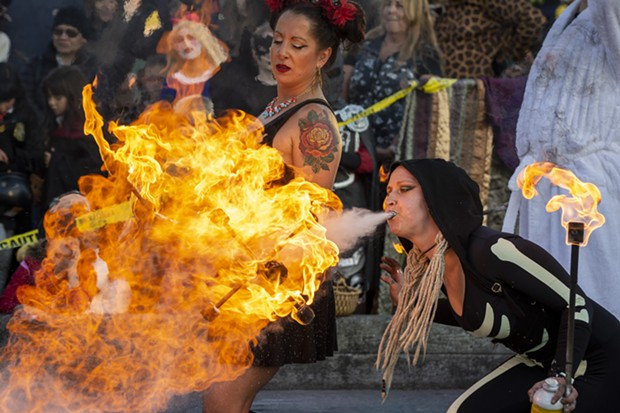 The Bella Vita Fire Dance Company burns it up on the Arcata Plaza. - PHOTO BY MARK LARSON