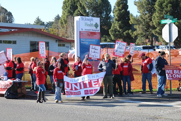 St. Joseph and Redwood Memorial Hospital healthcare workers striking in front of the St. Joseph Lane entrance to St. Joseph Hospital in Eureka. - IRIDIAN CASAREZ