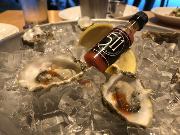 Oysters and housemade hot sauce. - PHOTO BY JENNIFER FUMIKO CAHILL