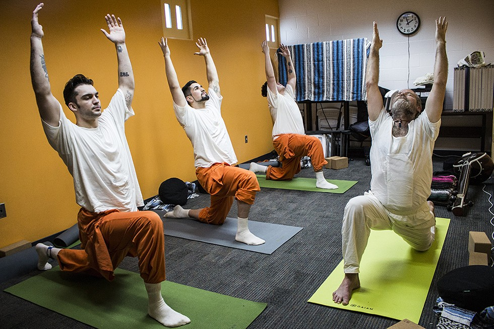 Rob Diggins (right) teaches a yoga class, a favorite of some inmates, inside the Humboldt County jail. - PHOTO BY T. WILLIAM WALLIN