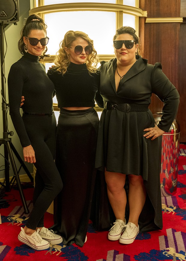 Jessica King, Carly Robbins and Klark Swan dressed for an action movie we would absolutely watch. - PHOTO BY ZACH LATHOURIS