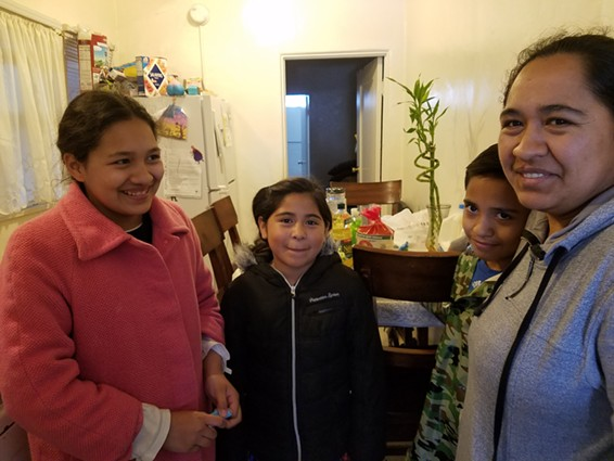 Los Angeles mother Adriana Fuentes, right, says she's not sure she can afford internet for her children Kimberly Fuentes, 13, Alejandra Delgado, 8, and Christopher Delgado, 10. - PHOTO BY ELIZABETH AGUILERA FOR CALMATTERS