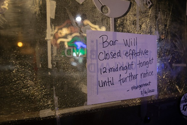 A sign on the door at Parkway Lounge in Oakland, California. - ANNE WERNIKOFF FOR CALMATTERS