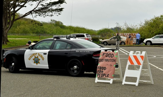 California Highway Patrol provided traffic control for the distribution, which drew more than 300 cars. - PHIL GUTIERREZ