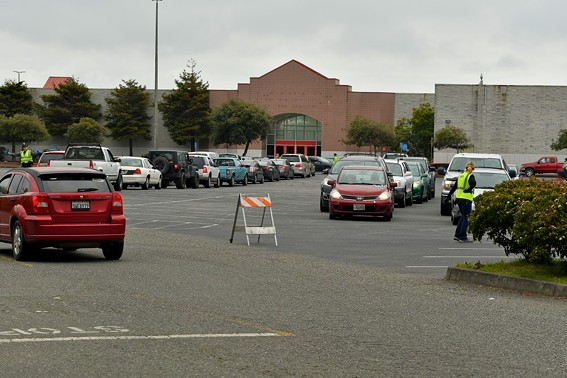 The north parking of the Bayshore Mall was full Friday with people picking up food boxes from Food for People. - PHIL GUTIERREZ