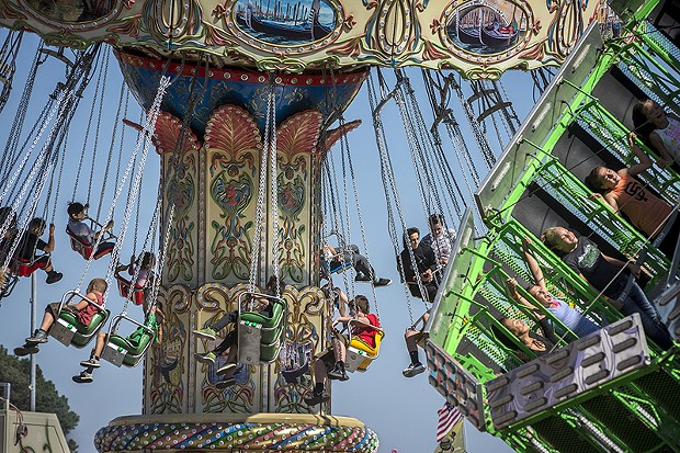 The midway rides were a popular way to catch a cool breeze. - PHOTO BY MARK LARSON
