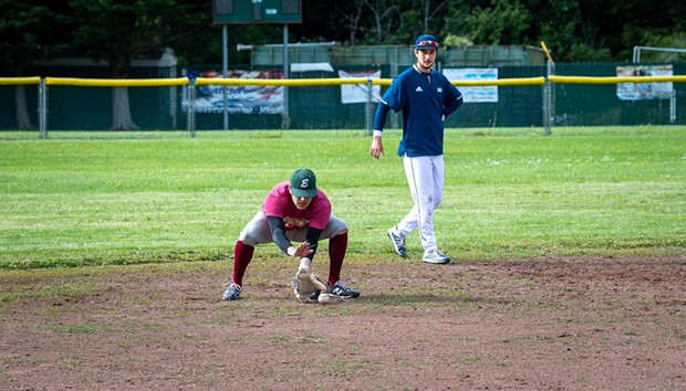 An Eagles hopeful fields a grounder during assessments at Redwood Fields. - MARK MCKENNA