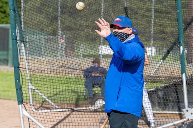 Coach Dan Joyner catches an incoming ball. - MARK MCKENNA