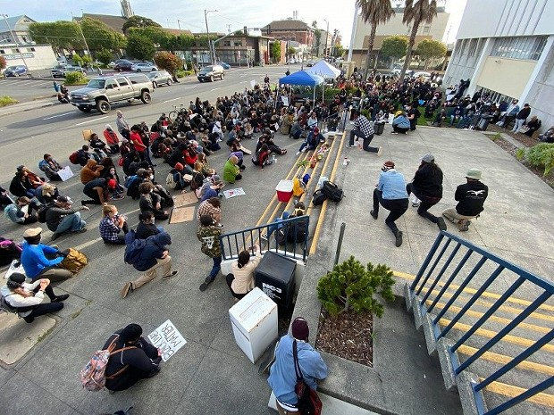 Protesters take a knee during a 10-minute moment of silence for George Floyd, who died Monday after a Minnesota police officer kneeled on his neck for more than eight minutes during an arrest. - MARK MCKENNA