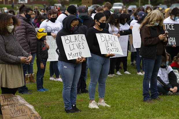 Demonstrators bow thier heads as they observe a moment of prayer to open a protest of police brutality and racism at Rohner Park in Fortuna on June 5. - THOMAS LAL