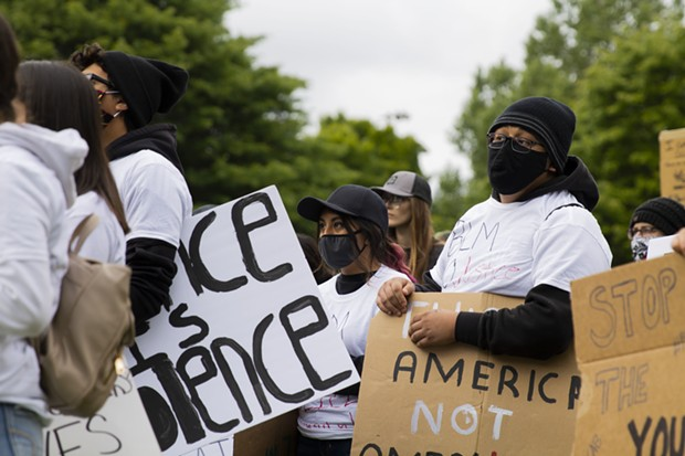 Demonstrators listen to speakers while holding signs at Rohner Park in Fortuna on June 5 following the death of George Floyd in police custody in Minneapolis. - THOMAS LAL