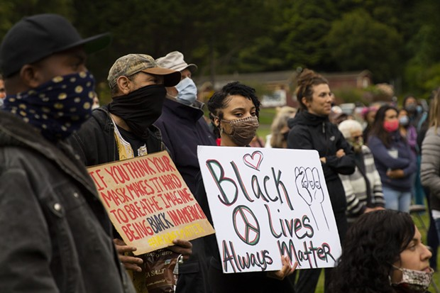 Demonstrators listen to speakers while holding signs at Rohner Park in Fortuna on June 5 following the death of George Floyd in Minneapolis Police custody. - THOMAS LAL