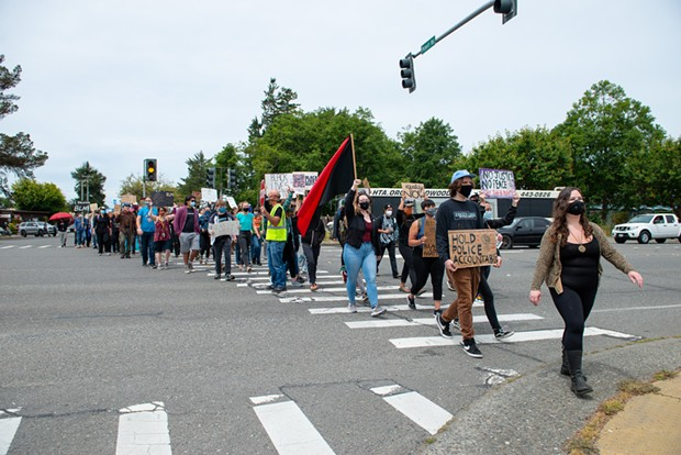 Several hundred protesters marched from an empty lot at the corner of Central Avenue and Pickett Road in McKinleyville to Pierson Park Thursday afternoon. - MARK MCKENNA