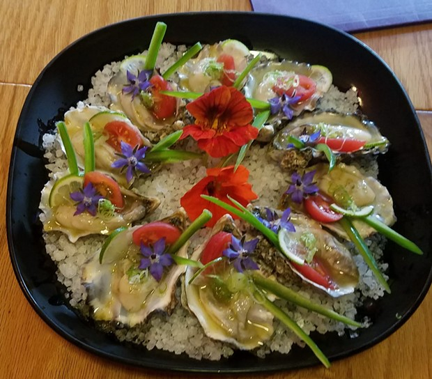 Yuzu vinagrette, cherry tomato, lime and jalapeño topped Sushi Spot's raw winner. - COURTESY OF MEREDITH DAY KLEIN