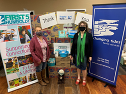 Star Mohatt (left), program coordinator for First 5 Humboldt and Kerry Venegas (right), executive director of Changing Tides Family Services with materials for child care providers. - SUBMITTED