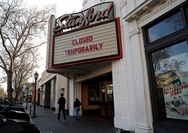 A sign outside of the Stanford Theatre announced its temporary closure in downtown Palo Alto on March 4, 2020. - PHOTO BY NHAT V. MEYER, BAY AREA NEWS GROUP