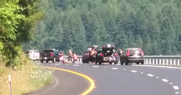 People tend to the injured motorcyclist. [Photo provided by Mark Nelson V]