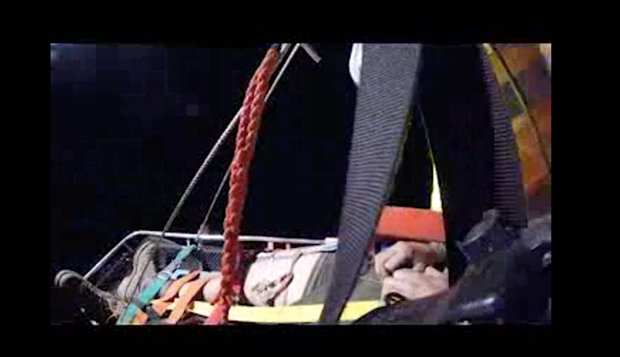 A screenshot from a video capturing the U.S. Coast Guard's rescue of two injured firefighters from the Middle Fire.