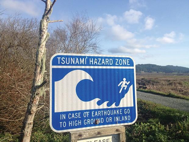Tsunami warning sign. - FILE