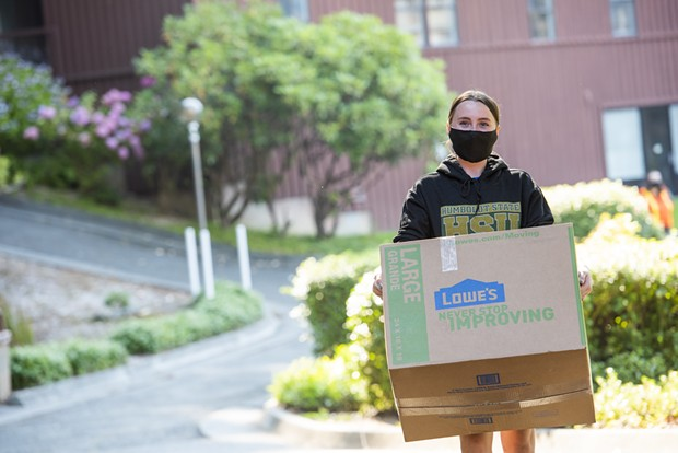 A student moves into a residence hall at HSU on Saturday, Aug. 15. - HSU
