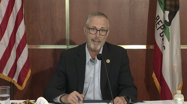 North Coast Rep. Jared Huffman questions Pacific Power Vice President Scott Bolton about the four dams his company operates on the Klamath River and their impact on water quality and fish populations. - SCREENSHOT FROM KEET'S LIVE BROADCAST