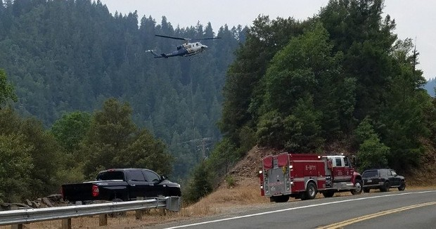 A helicopter hovers over the accident and fire. - PHOTO PROVIDED BY A LOCAL RESIDENT