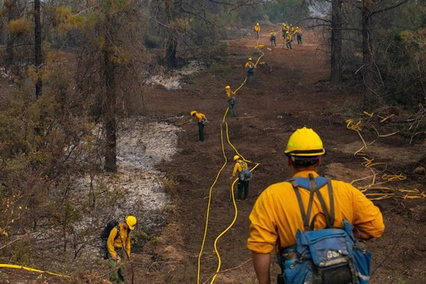"""""""Yesterday, Soldiers attached to the @RuggedSix, carry hoses & equipment to create a grid line to search for hotspots working to ensure a wildfire does not reignite at the #AugustComplex fire in @MendocinoNF."""" - US ARMY NORTH TWITTER"""
