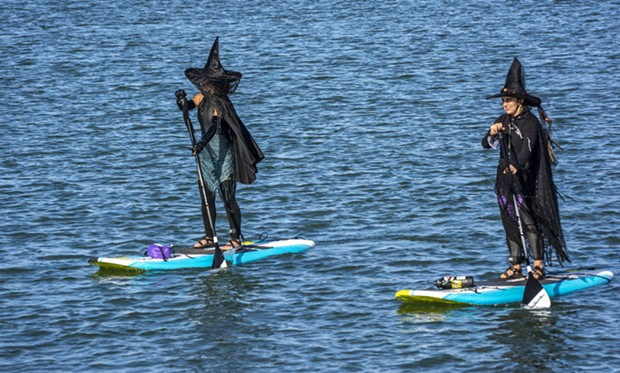These well-dressed witches on stand-up paddle boards headed back to the put-in location after turning around at the Samoa Bridge Boat Launch near Halvorsen Park. - PHOTO BY MARK LARSON