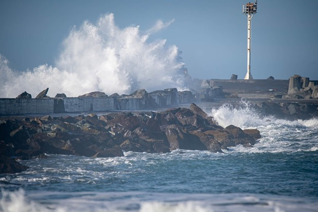 Waves breaking over the North Jetty today. - MARK MCKENNA PHOTOS AND VIDEO