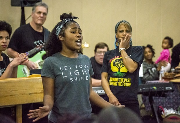 January – A soloist in the Healing and Compassion Spiritual Singers and Black Empowerment Dance Troupe helped close the Martin Luther King Birthday event in Eureka, with group director Valetta Molofsky looking on. - PHOTO BY MARK LARSON
