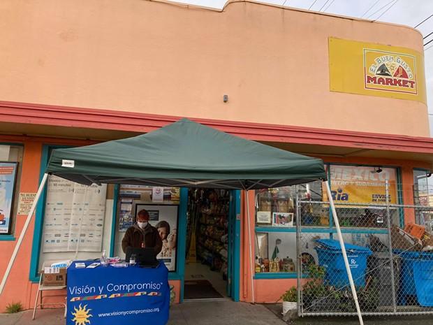 Ariel Fishkin, Visión y Compromiso community promotor, tabling in front of El Buen Gusto Market in Eureka. - SUBMITTED