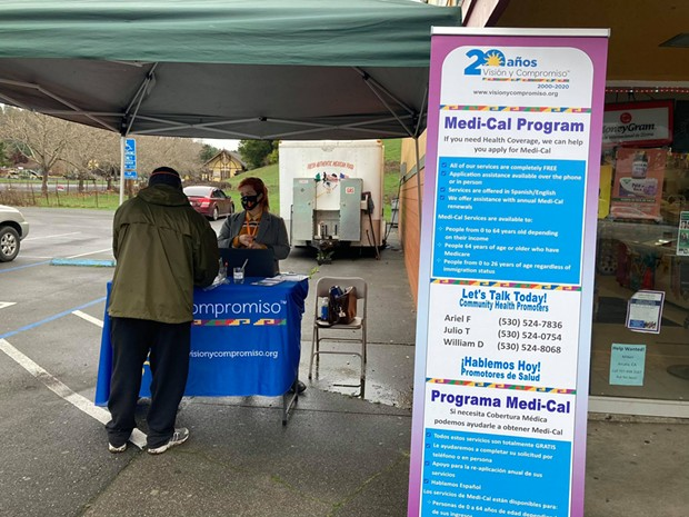 Ariel Fishkin, Visión y Compromiso community promotor, helping someone apply for Medi-Cal while outreaching. - SUBMITTED