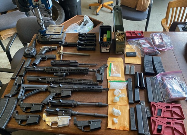 Weapons and drugs reportedly seized from the hotel room of Joseff Gene Greek. - SUBMITTED