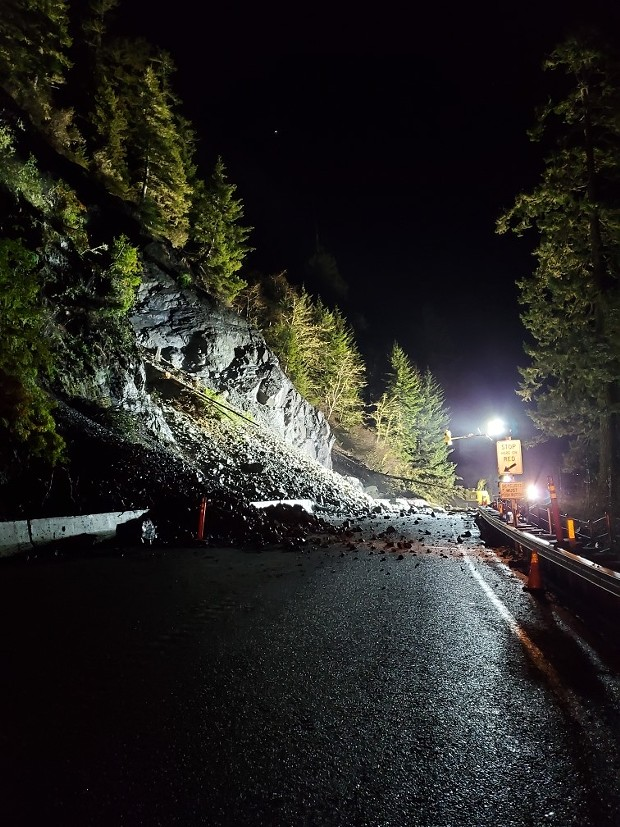 Caltrans' crews work to clear a landslide at Last Chance Grade on U.S. Highway 101. - CALTRANS